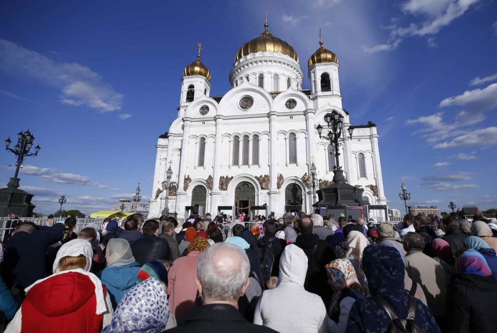 People queue to venerate the relics of Saint Nicholas being shown in the Christ the Saviour Cathedral, after his remains were sent to Russia on loan from their permanent home in Italy, in central Moscow