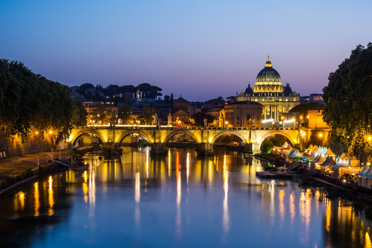 image of River Tiber, including: Ponte Sant Angelo and St. Peter's Basilica in the background. Rome - Italy.