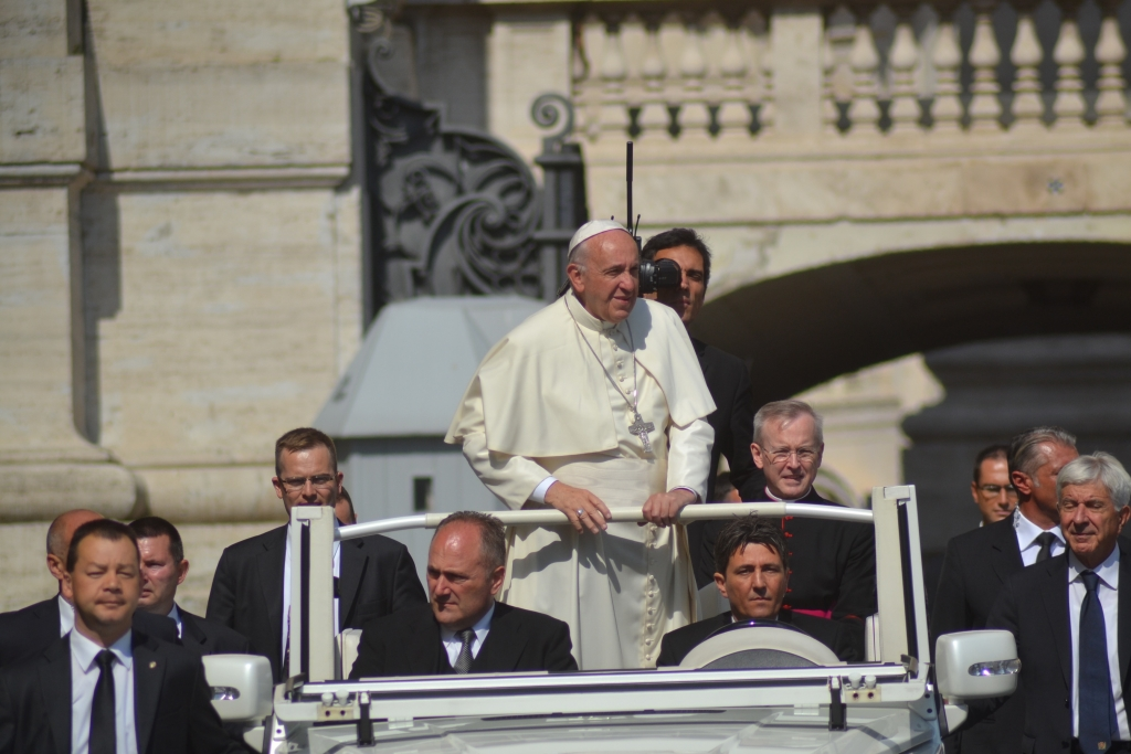 pope francis standing in his car