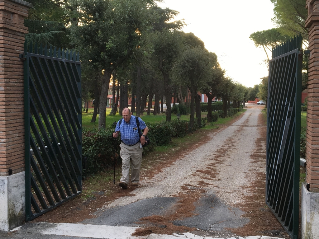 man walking through gates